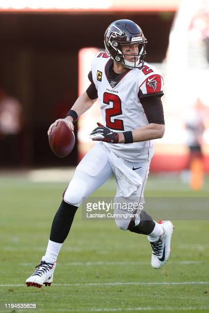 Quarterback Matt Ryan of the Atlanta Falcons scrambles with the ball in the second quarter against the San Francisco 49ers at Levi's Stadium on...