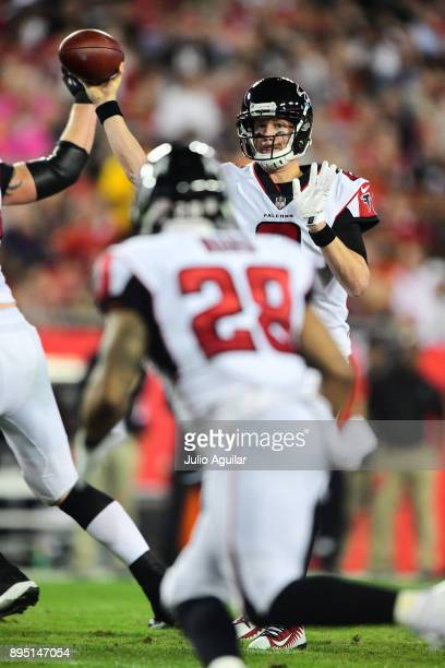 Quarterback Matt Ryan of the Atlanta Falcons throws a pass to running back Terron Ward in the first quarter against the Tampa Bay Buccaneers on...