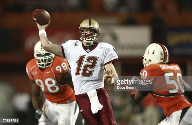 Quarterback Matt Ryan of the Boston College Golden Eagles throws a pass between defenders Baraka Atkins and Darryl Sharpton of the University of...