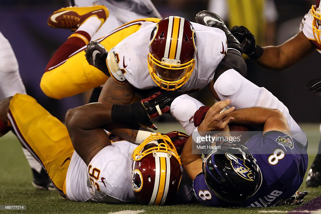 Quarterback Matt Schaub #8 of the Baltimore Ravens is sacked by nose tackle Chris Baker #92 of the Washington Redskins in the third quarter of a preseason game at M&T Bank Stadium on August 29, 2015 in Baltimore, Maryland.