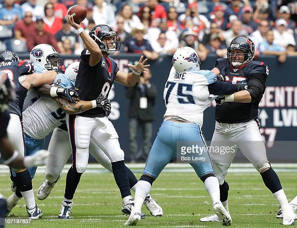Quarterback Matt Schaub of the Houston Texans attempts to release the ball as he is wrapped up by defensive end Jason Babin of the Tennessee Titans...