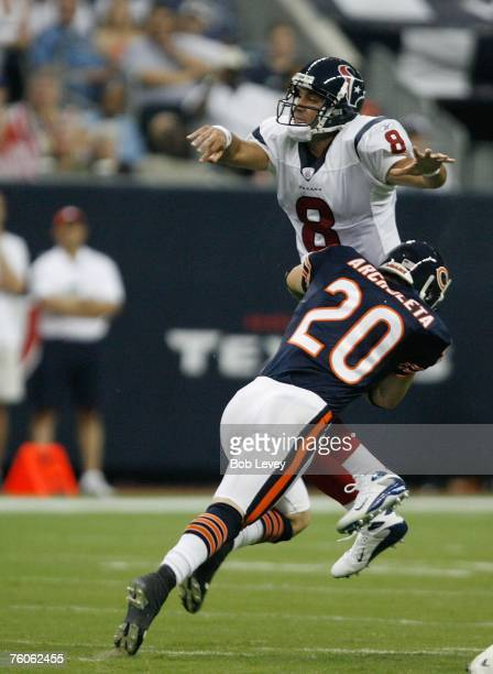 Quarterback Matt Schaub of the Houston Texans just gets a pass off as he his hit by safety Adam Archuleta of the Chicago Bears during first half of...