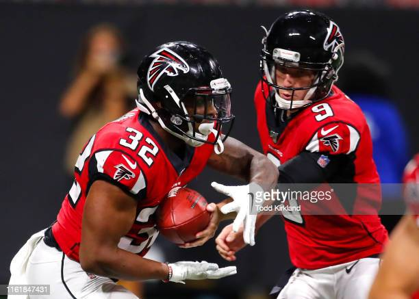Quarterback Matt Simms of the Atlanta Falcons hands off to Qadree Ollison during the second half of an NFL preseason game against the New York Jets...