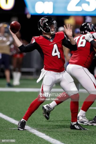 Quarterback Matt Simms of the Atlanta Falcons on a pass play during a preseason game against the Jacksonville Jaguars at MercedesBenz Stadium on...