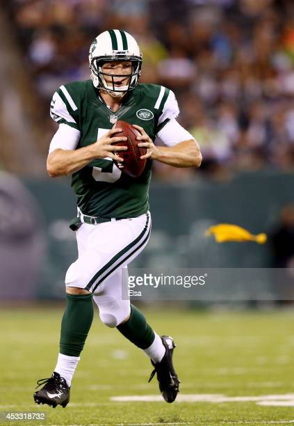 Quarterback Matt Simms of the New York Jets scrambles against the Indianapolis Colts during a preseason game at MetLife Stadium on August 7 2014 in...