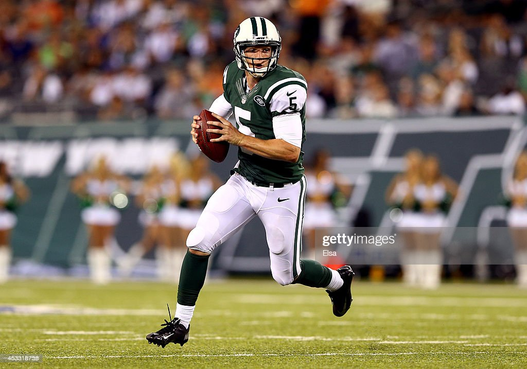 Quarterback Matt Simms #5 of the New York Jets scrambles against the Indianapolis Colts during a preseason game at MetLife Stadium on August 7, 2014 in East Rutherford, New Jersey.