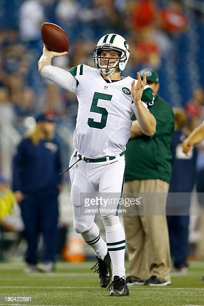 Quarterback Matt Simms of the New York Jets throws the ball during pregame before taking on the New England Patriots at Gillette Stadium on September...