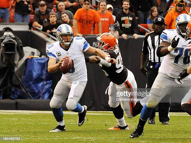 Quarterback Matthew Stafford of the avoids the tackle of Armonty Bryant of the Cleveland Browns during a game on October 13 2013 at FirstEngery...
