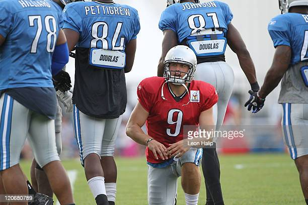 Quarterback Matthew Stafford of the Detroit Lions calls a play as the huddle breaks during Training Camp at the Detroit Lions Headquarters and...