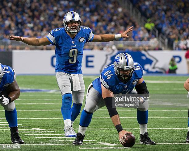 Quarterback Matthew Stafford of the Detroit Lions calls the play behind teammate center Travis Swanson during an NFL game against the Philadelphia...
