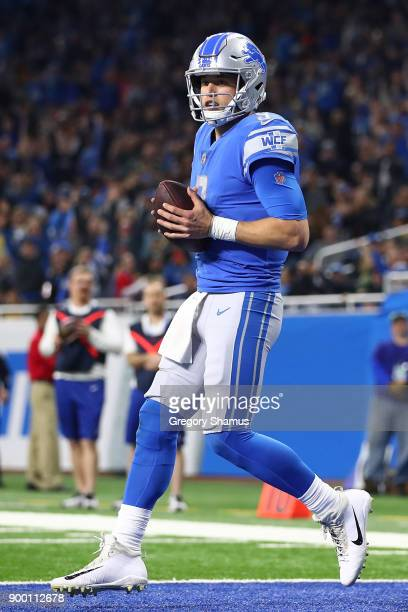 Quarterback Matthew Stafford of the Detroit Lions catches a two point conversion pass against the Green Bay Packers during the fourth quarter at Ford...