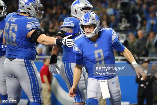 Quarterback Matthew Stafford of the Detroit Lions celebrates after catching a two point conversion pass against the Green Bay Packers during the...