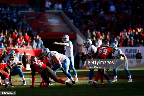 Quarterback Matthew Stafford of the Detroit Lions controls the offense during the fourth quarter of an NFL football game against the Tampa Bay...
