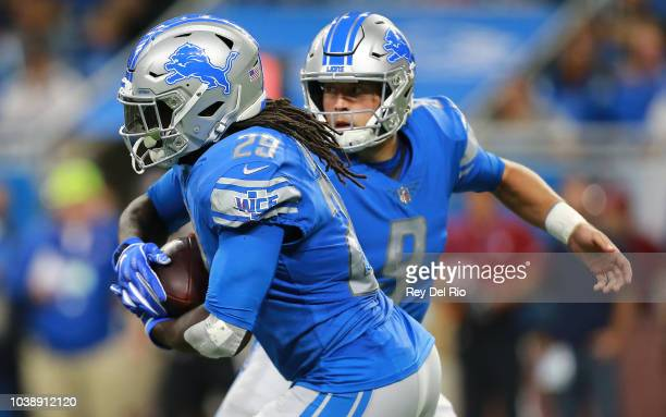 Quarterback Matthew Stafford of the Detroit Lions hands off the football to LeGarrette Blount against the New England Patriots during the first...