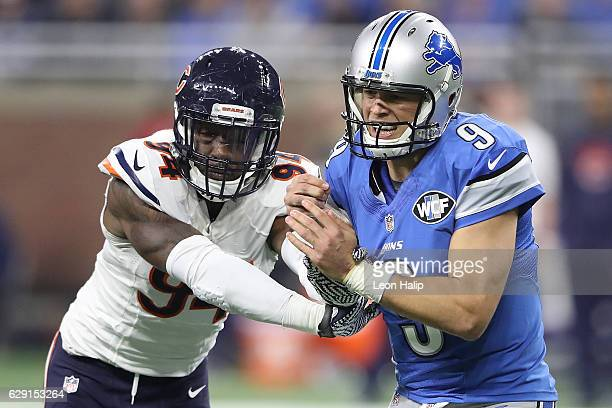 Quarterback Matthew Stafford of the Detroit Lions is hit by Leonard Floyd of the Chicago Bears during second quarter action at Ford Field on December...