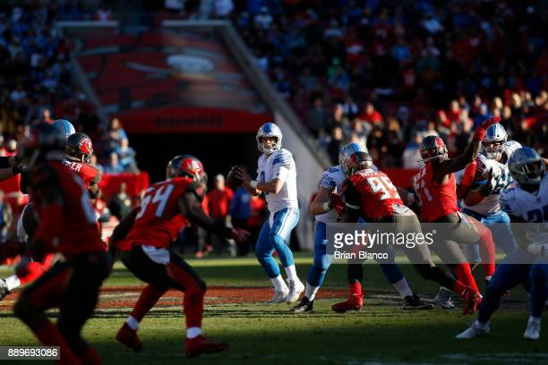 Quarterback Matthew Stafford of the Detroit Lions looks for a receiver during the fourth quarter of an NFL football game against the Tampa Bay...