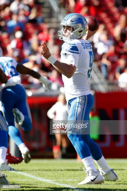 Quarterback Matthew Stafford of the Detroit Lions looks for an open receiver during the first quarter of an NFL football game against the Tampa Bay...