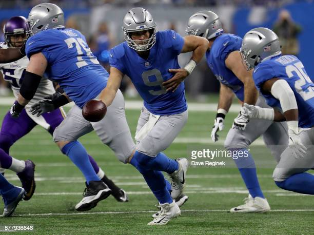 Quarterback Matthew Stafford of the Detroit Lions looks to hand off the football against the Minnesota Vikings during the first half at Ford Field on...