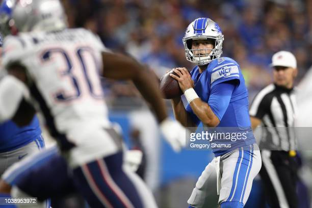Quarterback Matthew Stafford of the Detroit Lions looks to pass against the New England Patriots during the first half at Ford Field on September 23...