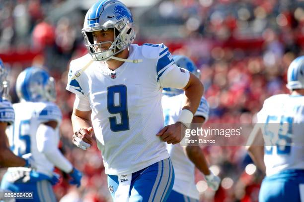 Quarterback Matthew Stafford of the Detroit Lions makes his way off the field during the first quarter of an NFL football game against the Tampa Bay...