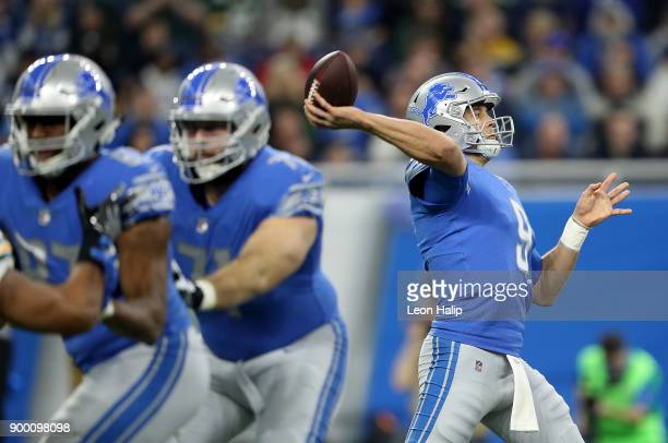 Quarterback Matthew Stafford of the Detroit Lions passes the ball against the Green Bay Packers during the first quarter at Ford Field on December 31...