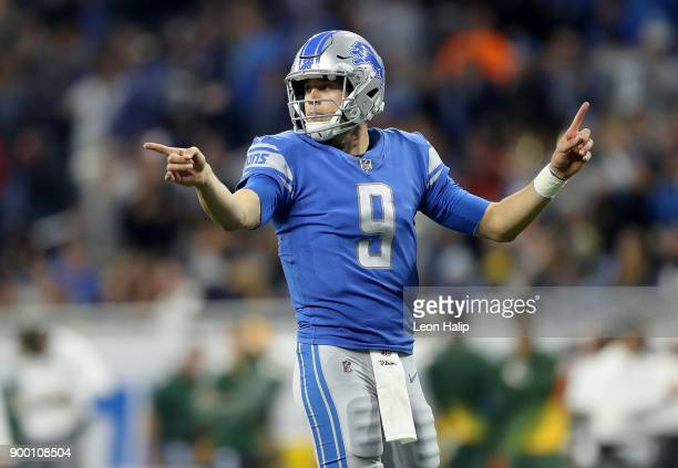Quarterback Matthew Stafford of the Detroit Lions signals to his team against the Green Bay Packers during the second half at Ford Field on December...