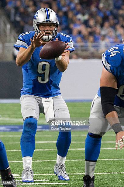 Quarterback Matthew Stafford of the Detroit Lions takes a snap from teammate center Travis Swanson during an NFL game against the Philadelphia Eagles...