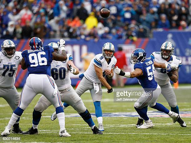 Quarterback Matthew Stafford of the Detroit Lions throws a pass against the New York Giants at MetLife Stadium on December 18 2016 in East Rutherford...