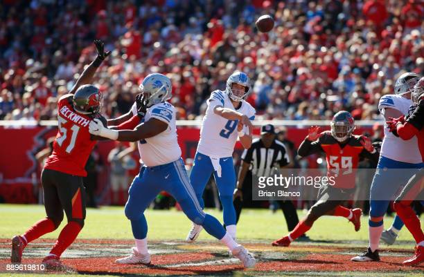 Quarterback Matthew Stafford of the Detroit Lions throws to an open receiver during the second quarter of an NFL football game against the Tampa Bay...