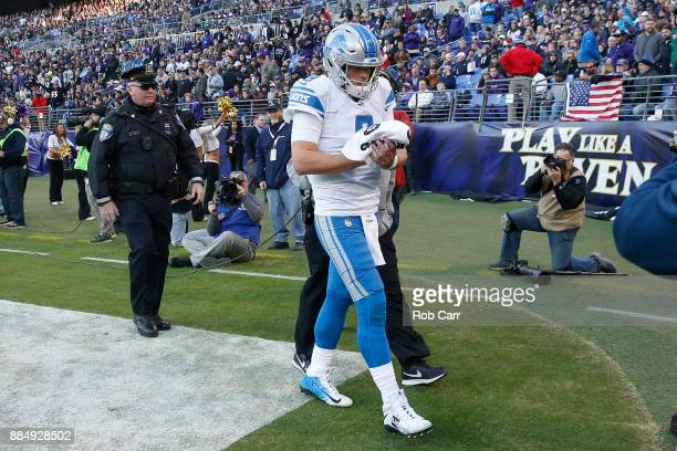 Quarterback Matthew Stafford of the Detroit Lions walks off the field after being injured in the fourth quarter against the Baltimore Ravens at MT...