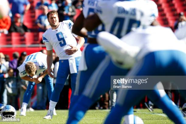 Quarterback Matthew Stafford of the Detroit Lions warms up with teammates before the start of an NFL football game against the Tampa Bay Buccaneers...