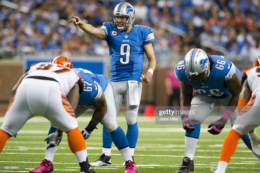 Quarterback Matthew Stafford #9 of the Detroit Lions yells to his players from the line of scrimmage during the first half against the Cincinnati Bengals at Ford Field on October 20, 2013 in Detroit, Michigan.