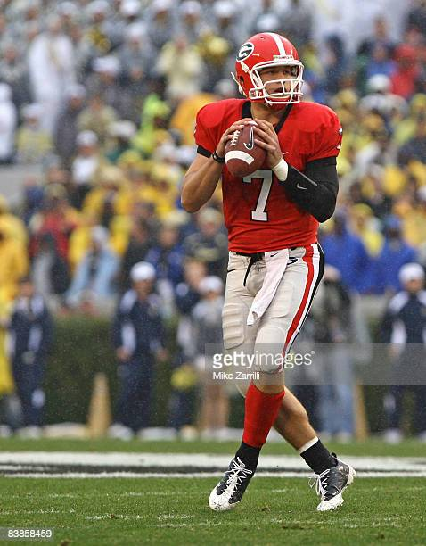 Quarterback Matthew Stafford of the Georgia Bulldogs drops back to pass during the game against the Georgia Tech Yellow Jackets during the game at...