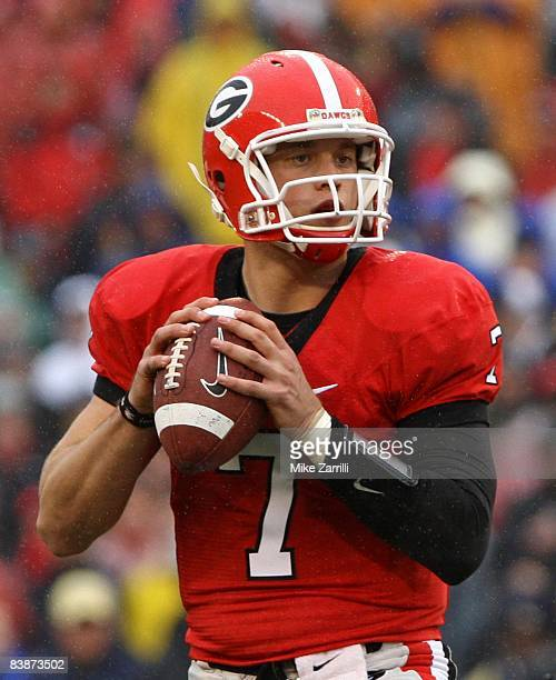 Quarterback Matthew Stafford of the Georgia Bulldogs drops back to pass during the game against the Georgia Tech Yellow Jackets at Sanford Stadium on...