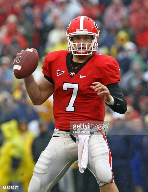 Quarterback Matthew Stafford of the Georgia Bulldogs looks downfield to pass during the game against the Georgia Tech Yellow Jackets during the game...