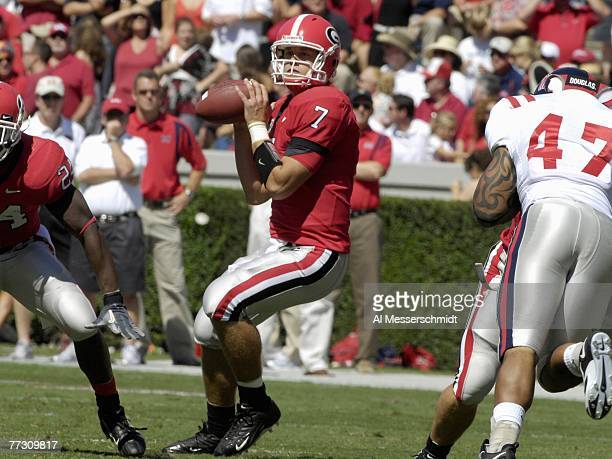 Quarterback Matthew Stafford of the Georgia Bulldogs sets to pass against the Mississippi Rebels at Sanford Stadium on September 29 2007 in Athens...
