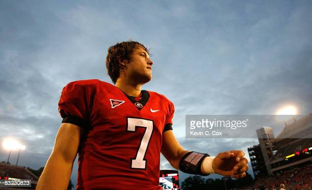 Quarterback Matthew Stafford of the Georgia Bulldogs walks off the field after defeating the Tennessee Volunteers 2614 at Sanford Stadium on October...