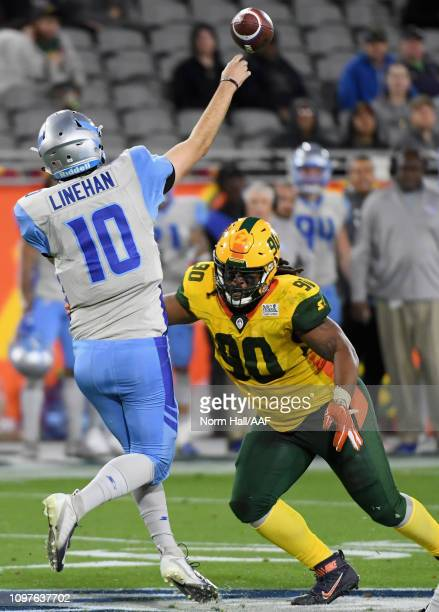 Quarterback Matt Linehan of the Salt Lake Stallions throws past Will Sutton III of the Arizona Hotshots during the second half of the Alliance of...