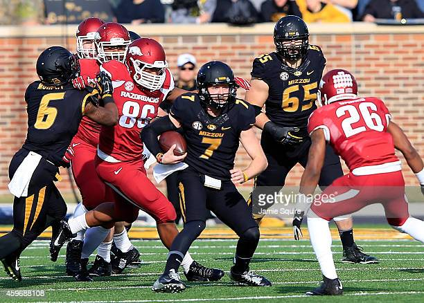 Quarterback Maty Mauk of the Missouri Tigers carries the ball during the game against the Arkansas Razorbacks at Faurot Field/Memorial Stadium on...