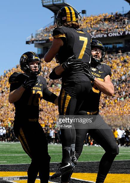 Quarterback Maty Mauk of the Missouri Tigers celebrates his touchdown run with Wesley Leftwich and tight end Sean Culkin against the Connecticut...