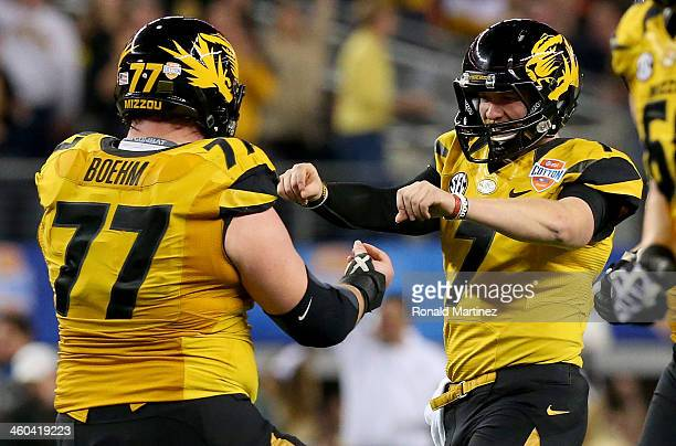 Quarterback Maty Mauk of the Missouri Tigers celebrates with Evan Boehm after Mauk throws a 24-yard touchdown pass in the second quarter against the...
