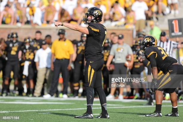 Quarterback Maty Mauk of the Missouri Tigers directs his team during a game against the South Dakota State Jackrabbits at Memorial Stadium on August...