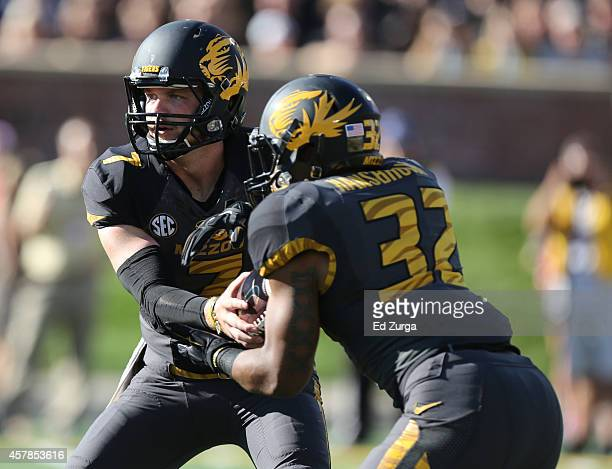 Quarterback Maty Mauk of the Missouri Tigers hands the ball off to Russell Hansbrough in the first quarter against the Vanderbilt Commodores at...