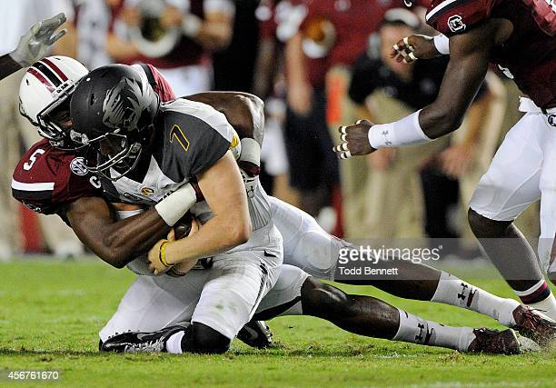 Quarterback Maty Mauk of the Missouri Tigers is brought down by defensive end Darius English during the second quarter on September 27 2014 at...