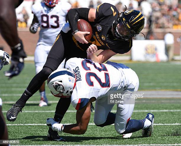 Quarterback Maty Mauk of the Missouri Tigers is hit and brought down by Andrew Adams of the Connecticut Huskies by in the fourth quarter at Memorial...