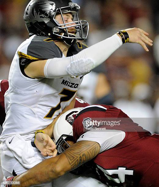 Quarterback Maty Mauk of the Missouri Tigers is hit by defensive end Mason Harris of the South Carolina Gamecocks during the third quarter on...