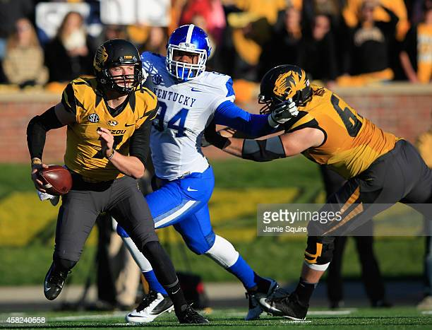 Quarterback Maty Mauk of the Missouri Tigers is looks to pass as he is persued by Za'Darius Smith of the Kentucky Wildcats during the second half of...