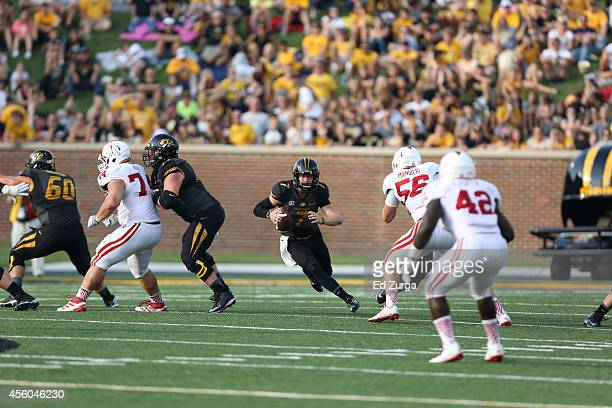 Quarterback Maty Mauk of the Missouri Tigers looks for running room against the Indiana Hoosiers at Memorial Stadium on September 20 2014 in Columbia...