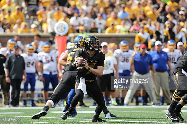 Quarterback Maty Mauk of the Missouri Tigers looks to pass against the South Dakota State Jackrabbits at Memorial Stadium on August 30 2014 in...