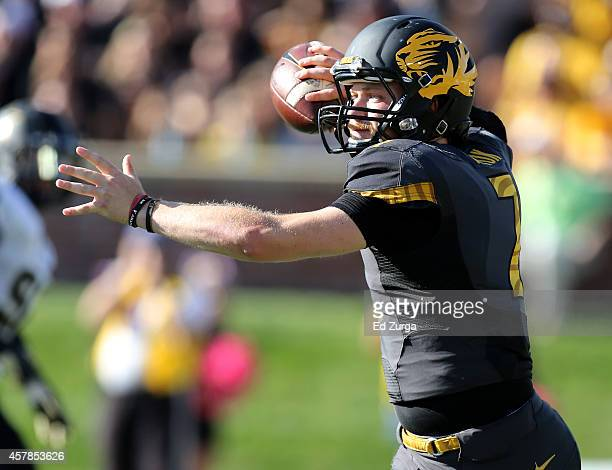 Quarterback Maty Mauk of the Missouri Tigers rolls out as he looks to pass in the first quarter against the Vanderbilt Commodores at Memorial Stadium...